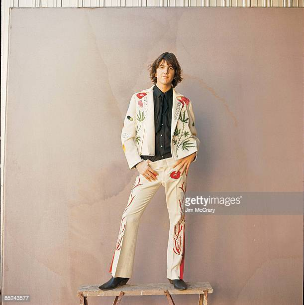 Photo of Gram PARSONS In front of AM Records Photo Studio in suit specially made for him by Nudie the rodeo tailor
