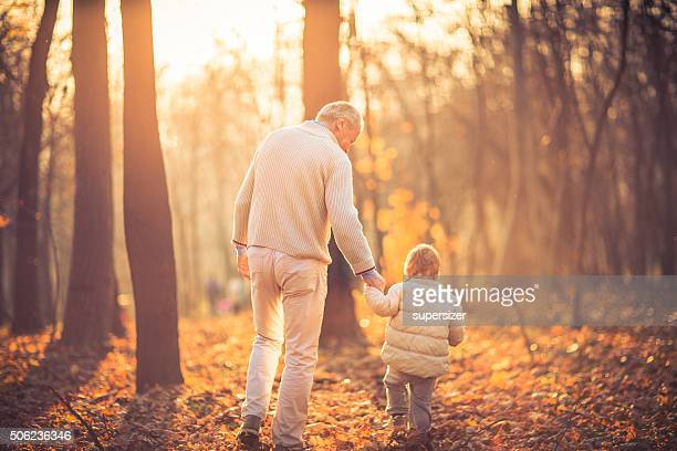 Photo of grandfather and his grandson in the park