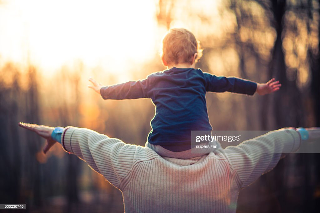 Photo of grandfather and his grandson in the park : Stock Photo