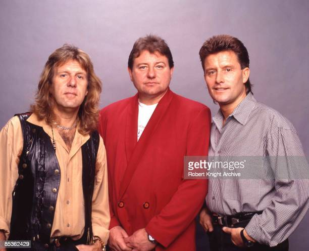 Photo of Greg LAKE and EMERSON LAKE & PALMER and Carl PALMER and Keith EMERSON; L-R: Keith Emerson, Greg Lake, Carl Palmer - posed, group shot at...