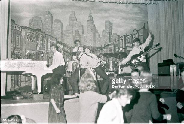 Photo of guest pianist Roy Young performing with drummer Pete Best singerguitarist John Lennon singerbassist Paul McCartney and guitarist George...