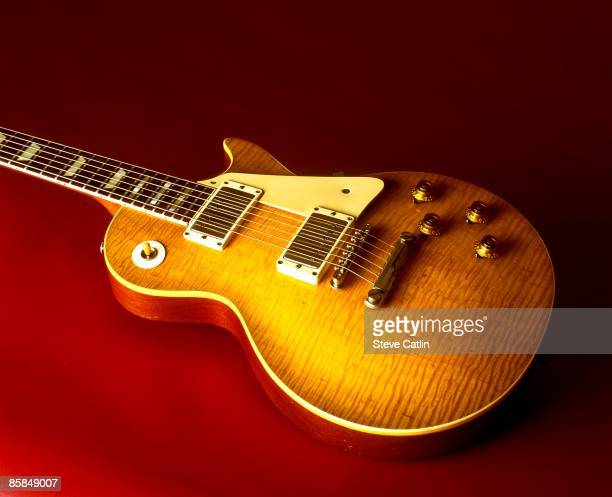 Photo of GUITAR and GIBSON GUITARS and GIBSON LES PAUL GUITAR Standard model featuring tiger stripe pattern to sunburst [209] still life studio
