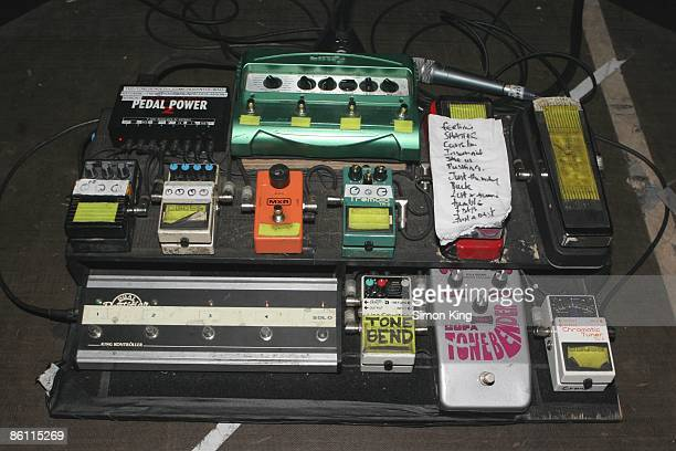 Photo of GUITAR EFFECTS PEDALS stage board of guitar effects pedals with setlist