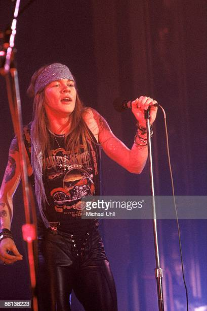 CLUB Photo of GUNS AND ROSES and Axl ROSE and GUNS ROSES and GUNS N' ROSES Axl Rose performing live onstage wearing Harley Davidson tshirt