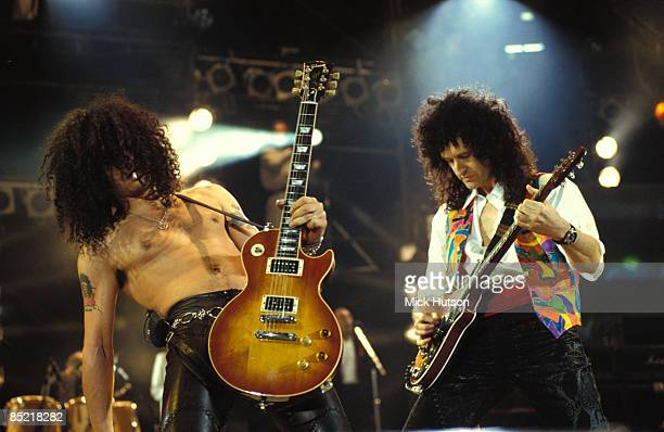 STADIUM Photo of GUNS AND ROSES and Brian MAY and SLASH and GUNS N' ROSES and GUNS ROSES Slash Brian May performing on stage at the Freddie Mercury...