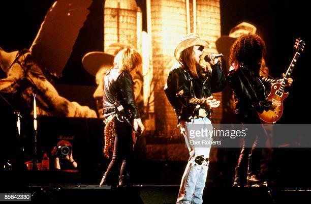 Photo of GUNS AND ROSES and SLASH and GUNS N' ROSES and GUNS ROSES and Axl ROSE and Duff McKAGAN LR Duff McKagan Axl Rose Slash performing live...
