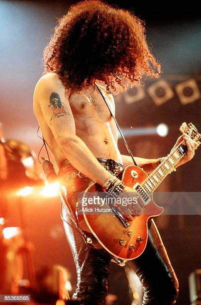 Photo of GUNS & ROSES and SLASH and GUNS N' ROSES and GUNS AND ROSES, Slash performing live onstage at the Freddie Mercury Tribute Concert, playing...
