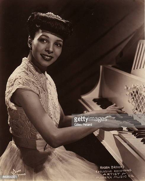 Photo of Hadda BROOKS posed at piano