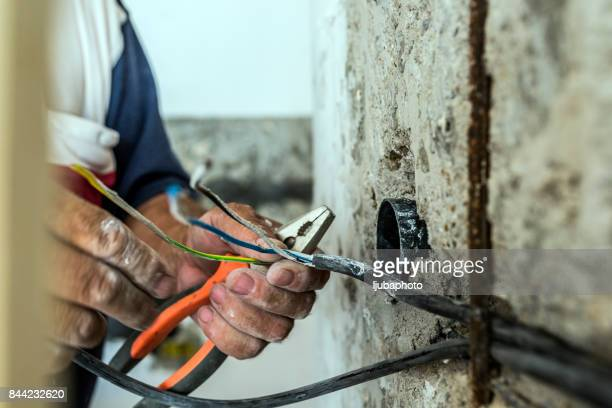 Photo of Hand striping the insulation of wires