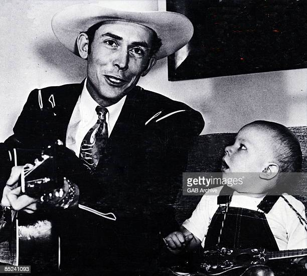Photo of Hank WILLIAMS Jnr and Hank WILLIAMS; With son Hank Williams jr