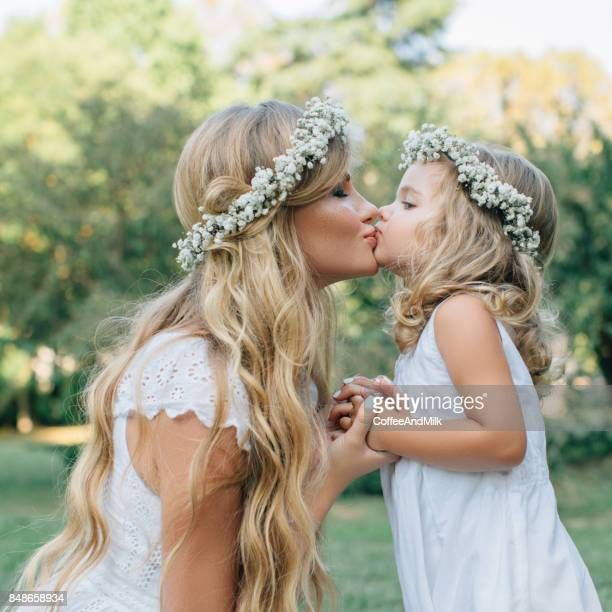 photo of happy mother and her little daughter - gorgeous babes stock photos and pictures