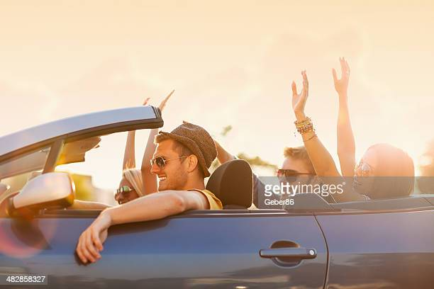 Photo of happy young people in convertible car