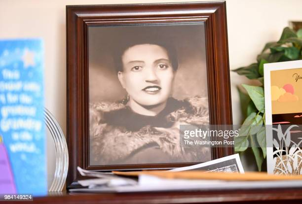 A photo of Henrietta Lacks sits in the living room of her grandson Ron Lacks n Baltimore MD on March 22 2017