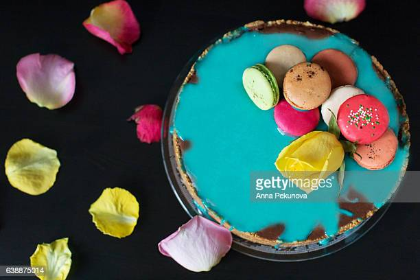 Photo of hot chocolate cheesecake with french macaroons on a desktop