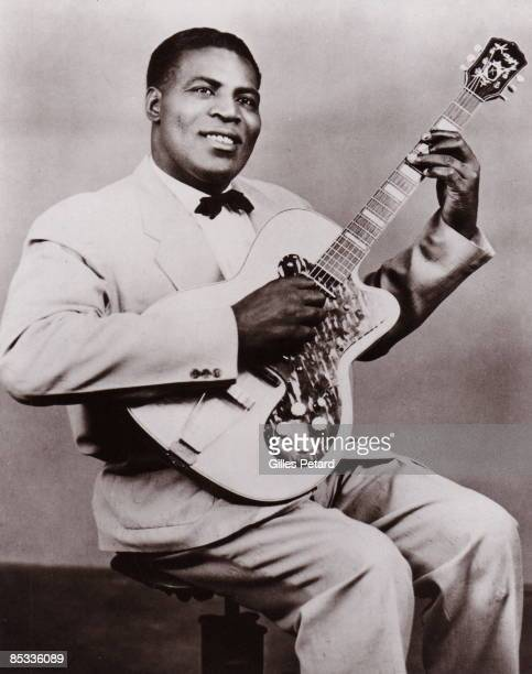 Photo of Howlin' WOLF; Posed studio portrait of Howlin' Wolf, with guitar