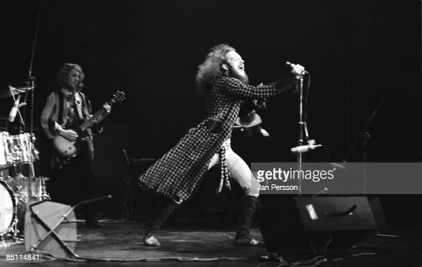 Photo of Ian ANDERSON and JETHRO TULL and Martin BARRE Ian Anderson with Martin Barre behind performing live onstage with Jethro Tull