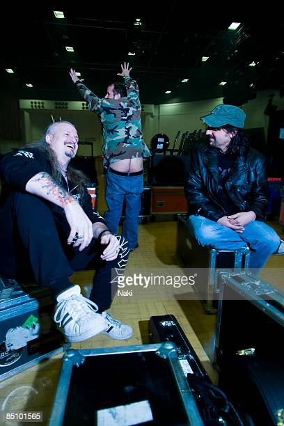 Photo of ICED EARTH and Troy SEELE and Jon SCHAFFER and Tim OWENS Jon Schaffer and Troy Seele watch Tim Ripper Owens mooning backstage