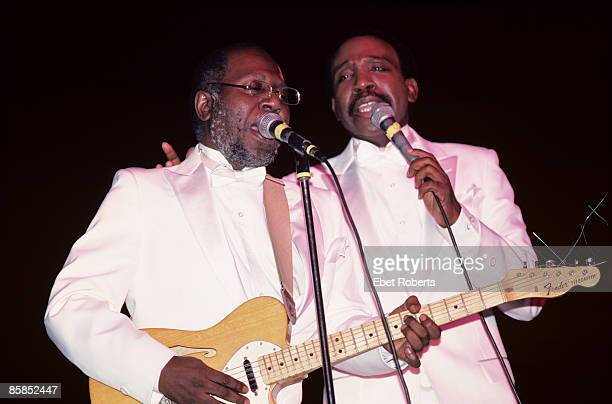 Photo of IMPRESSIONS and Curtis MAYFIELD and Jerry BUTLER, Curtis Mayfield and Jerry Butler performing on stage
