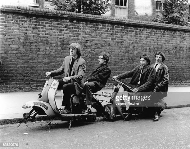 Photo of INGOES Posed group portrait on scooters with no wheels LR Brian Godding Jim Cregan Kevin Westlake and Brian Balshaw