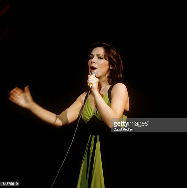 Photo of Irish singer DANA performing live on stage in a London Television studio.