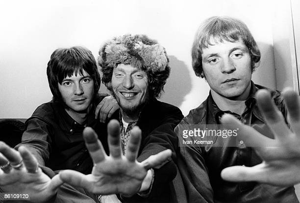 GO Photo of Jack BRUCE and CREAM and Eric CLAPTON and Ginger BAKER LR Eric Clapton Ginger Baker Jack Bruce posed studio group shot backstage at...