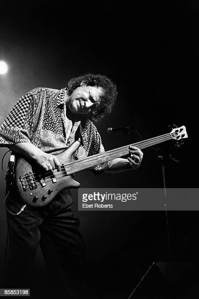 Photo of Jack BRUCE; Jack Bruce performing on stage, playing Warwick fretless bass guitar