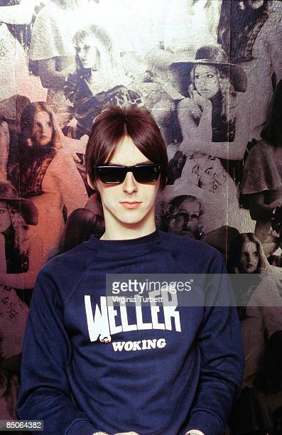 Photo of JAM and Paul WELLER of The Jam posed wearing sunglasses and sweatshirt reading 'Weller Woking'in Lonsdale style