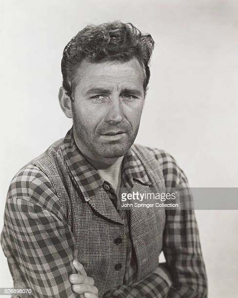 Photo of James Agee , famous American critic and novelist, standing with his arms folded. Ca. 1952.