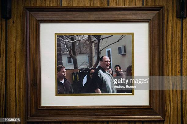 A photo of James Gandolfini playing the character Tony Sopranos while on set of the HBO show The Sopranos hangs on the wall at Holsten's the...
