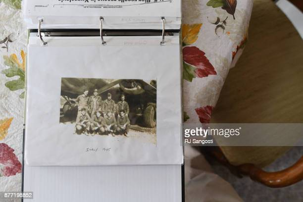 A photo of James Gourley and the rest of his World War II B17 crew from 1945 is put in a threering notebook with other photos letters and and...