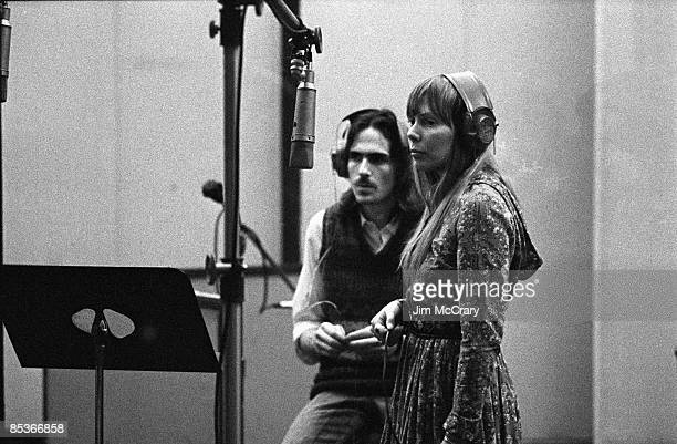 Photo of James TAYLOR and Joni MITCHELL w/ James Taylor recording backing vocals on Carole King's album Tapestry