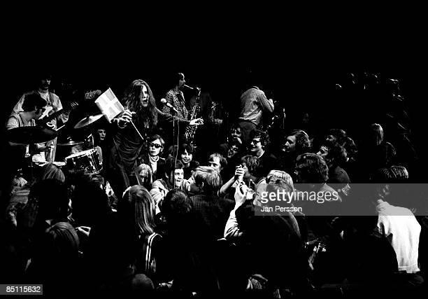 Photo of Janis JOPLIN Janis Joplin performing live onstage amongst audience
