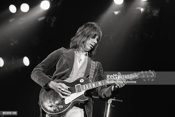 Photo of Jeff BECK Jeff Beck performing on stage playing Gibson Les Paul guitar