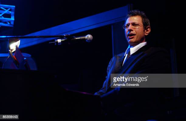 HOLLYWOOD Photo of Jeff Goldblum in Los Angele Jeff Goldblum performs at the Children Uniting Nations Rock The Vote and Creative Coalition Oscar...