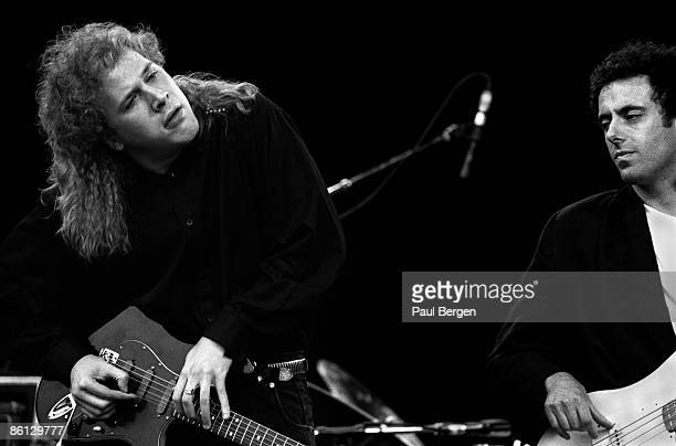 Photo of Jeff HEALEY and Joe ROCKMAN, Blind guitarist Jeff Healey performing on stage, with Joe Rockman on bass