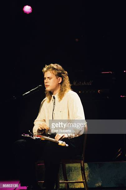 Photo of Jeff HEALEY, Blind guitarist Jeff Healey performing on stage, sitting