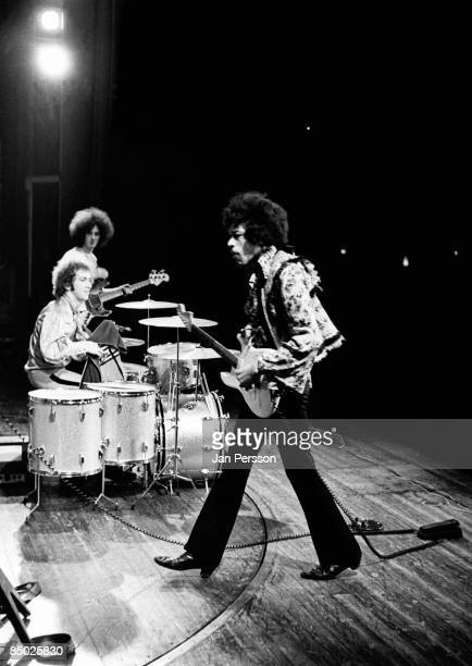 Photo of Jimi Hendrix 1 Jimi Hendrix in the background drummer Mitch Mitchell and basplayer Noel Redding Tivolis Koncertsal January 7 1968