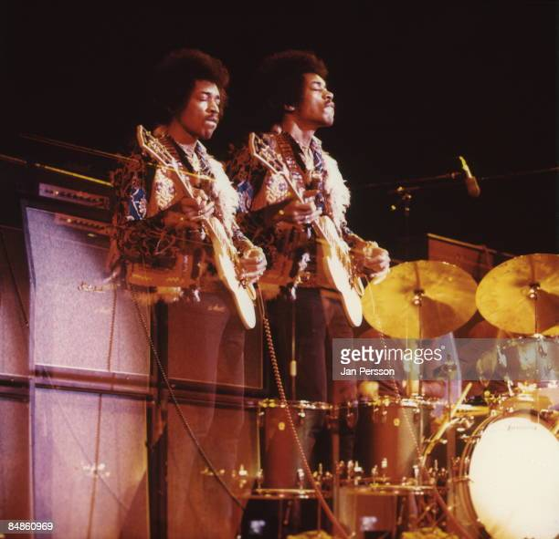 Photo of Jimi HENDRIX performing live onstage at Falkoner Centret playing Gibson SG guitar with Marshall amplifiers behind