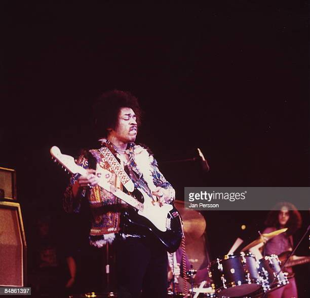 Photo of Jimi HENDRIX with Noel Redding on right performing live onstage at Falkoner Centret