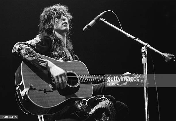 Photo of Jimmy PAGE and LED ZEPPELIN, Jimmy Page performing live onstage, playing acoustic guitar