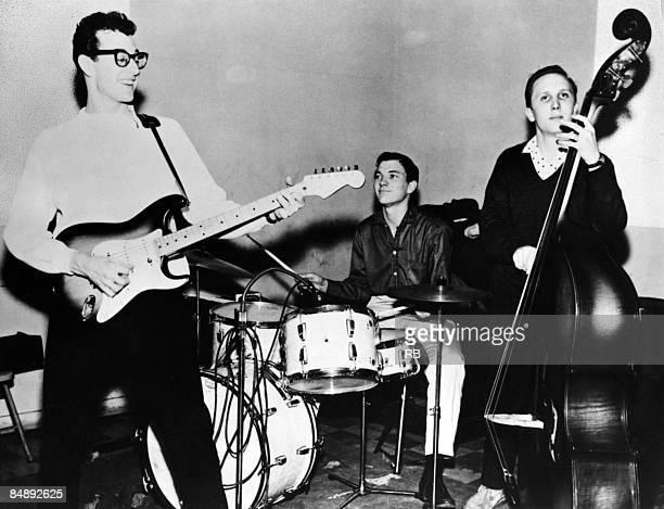 Photo of Joe B MAULDIN and Jerry ALLISON and Buddy HOLLY and CRICKETS LR Buddy Holly and Jerry Allison and Joe B Mauldin of The Crickets performing...