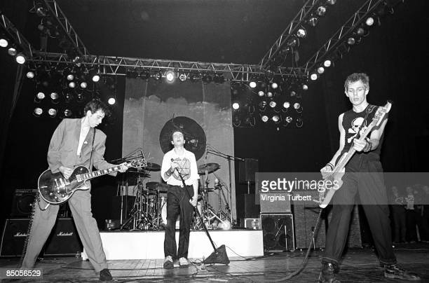 Photo of Joe STRUMMER and CLASH and Mick JONES and Paul SIMONON, L-R: Mick Jones, Joe Strummer, Paul Simonon - performing live onstage at Rock...