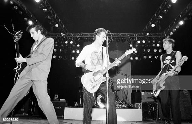 THEATRE Photo of Joe STRUMMER and CLASH and Mick JONES and Paul SIMONON LR Mick Jones Joe Strummer Paul Simonon performing live onstage at Rock...