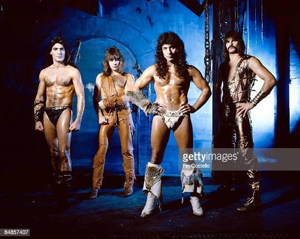 Photo of Joey DeMAIO and Ross FRIEDMAN and Scott COLUMBUS and MANOWAR and Eric ADAMS Posed studio group portrait full length barechested LR Joey...