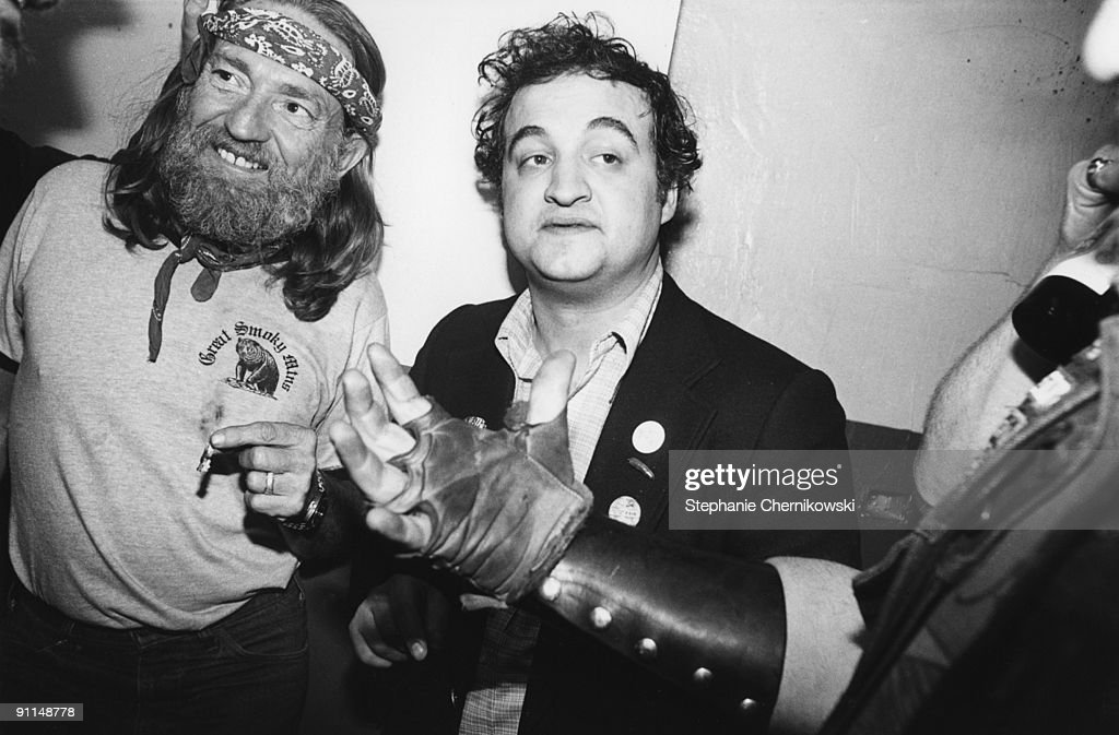Photo of John BELUSHI and Willie NELSON; L-R. Willie Nelson, John Belushi at the lone star cafe nyc, willie & belushi hanging out backstage, at the aftershow party following willie's first appearance on saturday night live. later 70s., sc