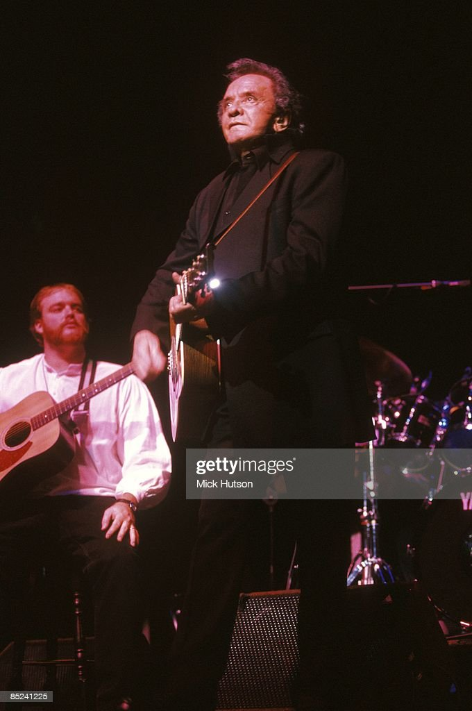 HALL Photo of John Carter CASH and Johnny CASH, Johnny Cash performing on stage with son John Carter Cash