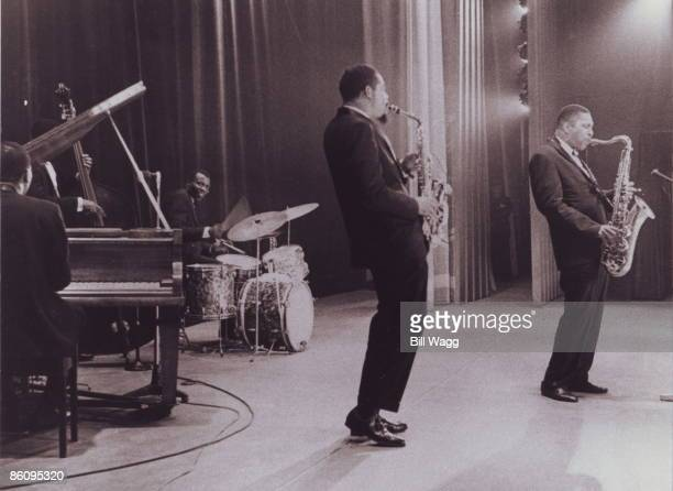 HALL Photo of John COLTRANE and Elvin JONES and Eric DOLPHY LR Elvin Jones Eric Dolphy and John Coltrane performing on stage