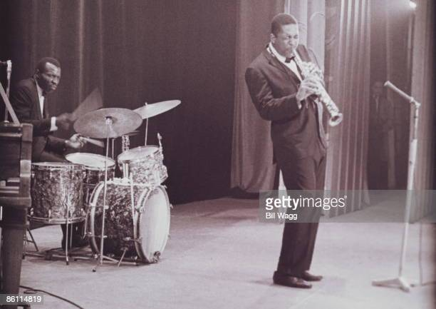 HALL Photo of John COLTRANE and Elvin JONES Drummer Elvin Jones and John Coltrane performing on stage