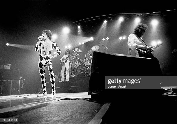 Photo of John DEACON and QUEEN and Freddie MERCURY and Roger TAYLOR LR Freddie Mercury John Deacon Roger Taylor Brian May performing live on stage at...
