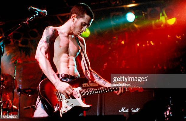 Photo of John FRUSCIANTE and RED HOT CHILI PEPPERS John Frusciante performing live onstage playing Fender Stratocaster guitar